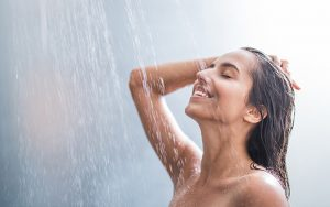 Woman having a shower with filtered water