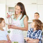 Famnily enjoying a bottle of water purified through reverse osmosis