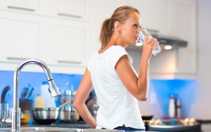Woman Drinking Water - Water Filtration System Article by Biopure Water for Life